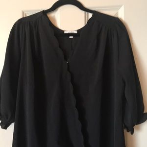 Black blouse with scalloped detail